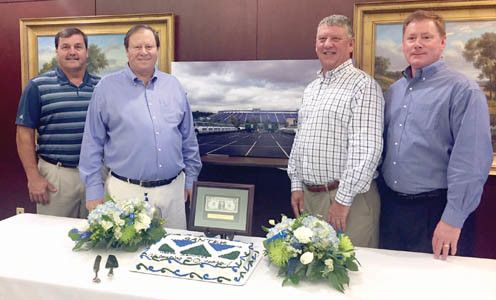 SANTEK WASTE SERVICES CEO and owner Kenneth Higgins, second from left, celebrates the company's 30th anniversary with members of his management team. From left are Executive Vice President of Operations Matt Dillard, Higgins, Chief Business Development Officer Eddie Caylor and Chief Operations Officer Tim Watts. Led by CEO and owner Kenneth Higgins, employees were treated …