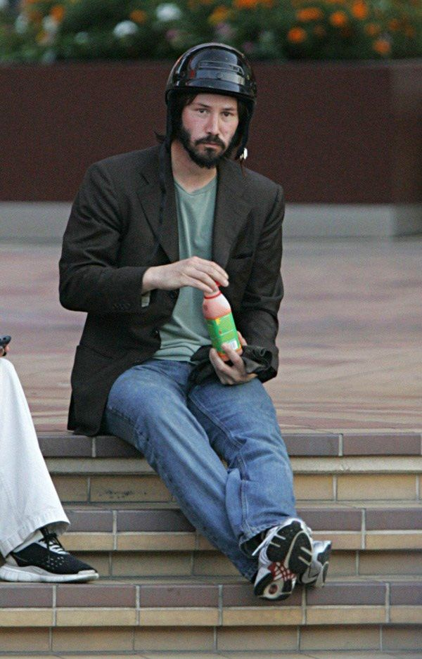 Sad Keanu drinking juice