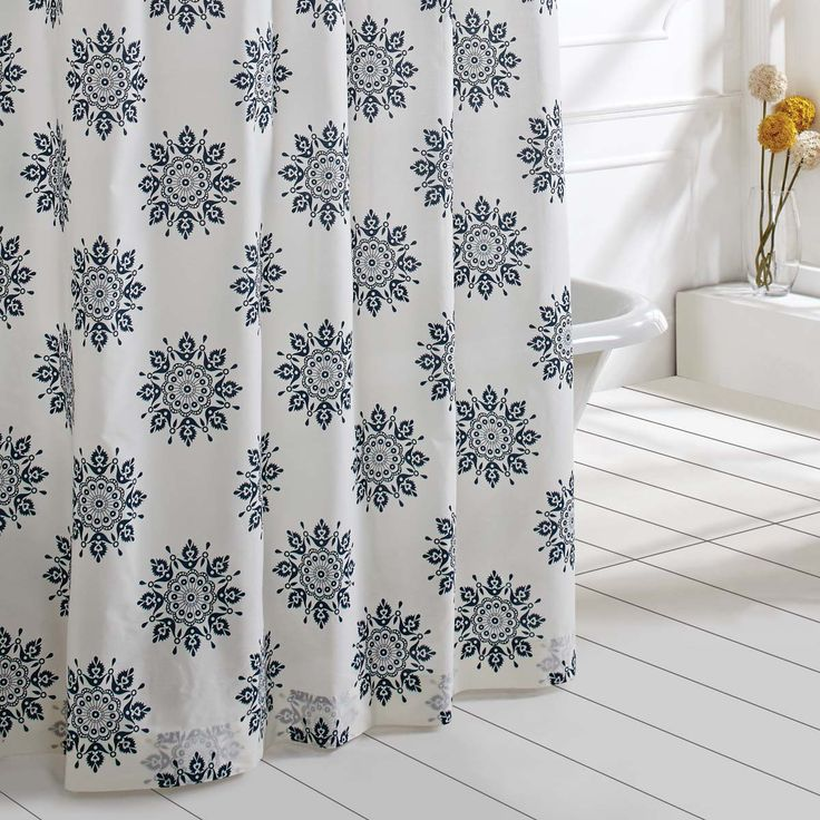 Blue, White 72x72 With a repeating medallion motif on creme cotton cambric fabric, the Mariposa Indigo Shower Curtain adds a colorful design element to your bathroom. Single Fabric; Machine stitched;
