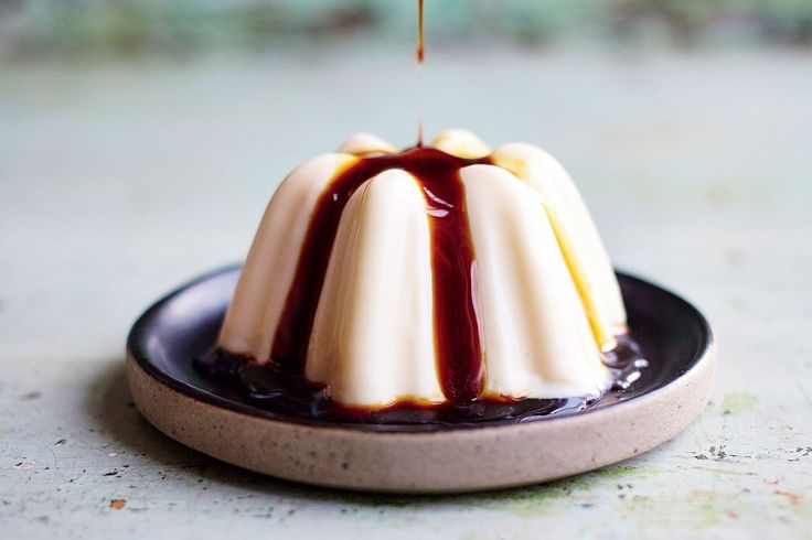 Two of Italy's greatest desserts come together for this panna cotta with an affogato twist. If you don't have panna cotta moulds, serve them in nice glasses.