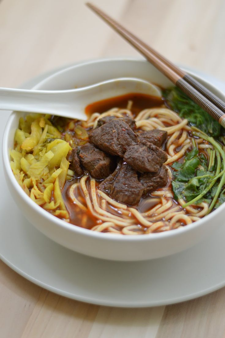 Beef noodle soup - National dish of Taiwan. Soup with stewed or braised beef, noodles, vegetables in beef broth.