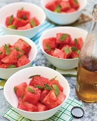 Watermelon Salad w/ mint, lime juice, pinch of cayenne & a splash of rum. Best watermelon salad ever!