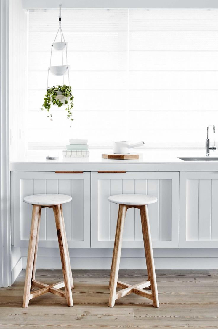 The best bar stools for every budget. These marble-topped pieces are by Harpers Project.