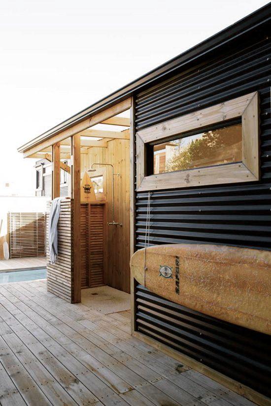 Nice outdoor shower and corrugated walls.