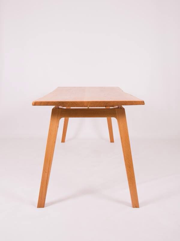 "She is a light filled table and all together classy. With a real inspiration from mid century furniture design and relying on the beauty of the natural world for the top. Maeker Studio brings you ""Delilah"".    French oak, hand polished brass pins and finished by hand with danish oil."