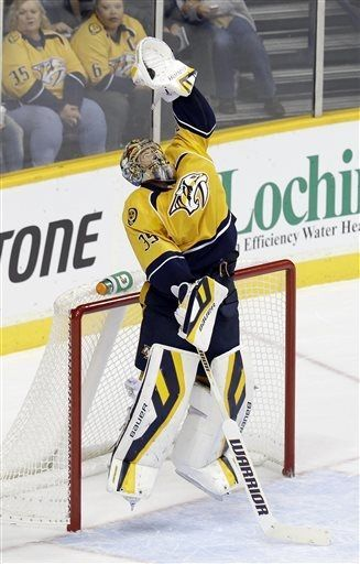 Nashville Predators goalie Pekka Rinne, of Finland, jumps to make a stop against the Los Angeles Kings in overtime