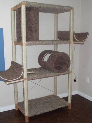 Great DIY cat furniture idea out of re-purposed storage shelves! Wonderful multilevel lounging for several cats, by a window would be even better!