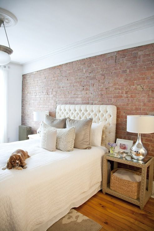 Suzie: The Elegant Abode - City bedroom  with exposed brick wall, white tufted headboard, gray ...