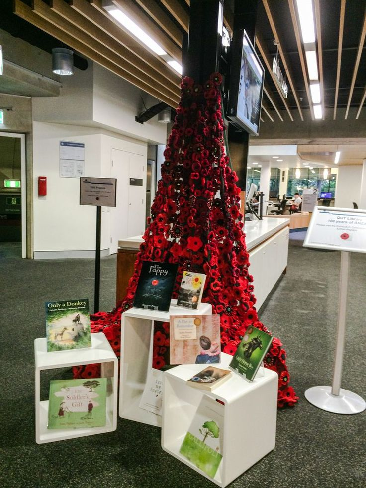 A drape of crocheted and felted poppies made by staff at QUT Library, Kelvin Grove campus for an Anzac Day Display.