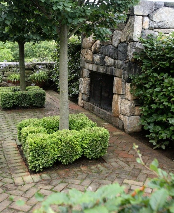 Connecticut patio designed by Doyle Herman Design Associates. The brick color was carefully selected to blend with the stone fireplace.