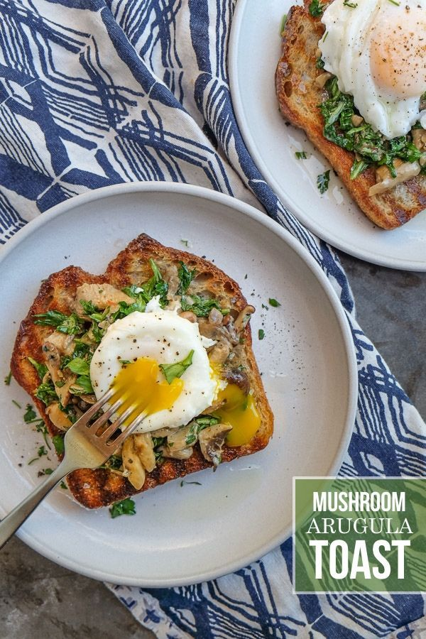 Creamy Mushroom Arugula Toast with Poached Eggs. Find the recipe on http://Shutterbean.com