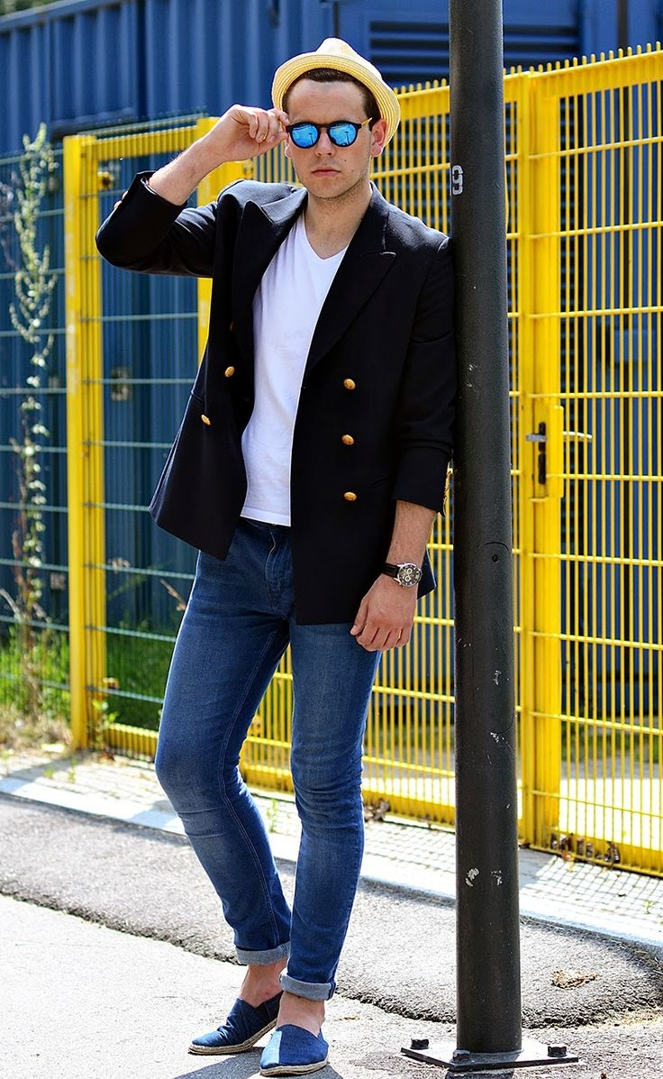 Shop this look for $189:  http://lookastic.com/men/looks/hat-and-sunglasses-and-v-neck-t-shirt-and-double-breasted-blazer-and-watch-and-skinny-jeans-and-espadrilles/3142  — Yellow Straw Hat  — Blue Sunglasses  — White V-neck T-shirt  — Navy Double Breasted Blazer  — Black Leather Watch  — Blue Skinny Jeans  — Navy Canvas Espadrilles