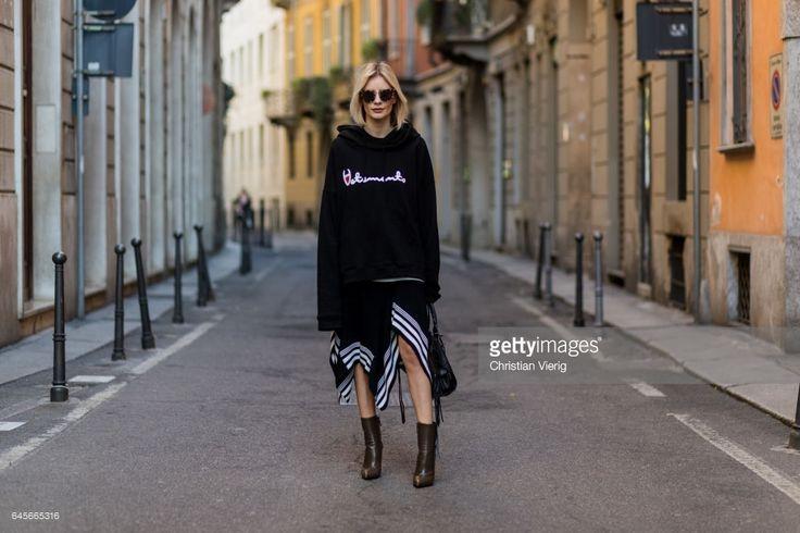 Lisa Hahnbueck wearing Vetements Sweatshirt, Designers Remix draped rip knit, Balenciaga Boots, Balenciaga Motorcycle bag, Prada Sunglasses during Milan Fashion Week Fall/Winter 2017/18 on February 26, 2017 in Milan, Italy.