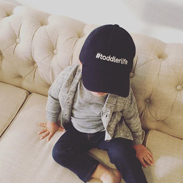 Where this mini can always be found - watching The Jungle Book. #thesimplebarenecessities • • • #toddlerlife #mininoggins #baseballcap #hatsforkids #minihat #minis #boymom #momlife #mommylife #embroidery #shopsmall #junglebook