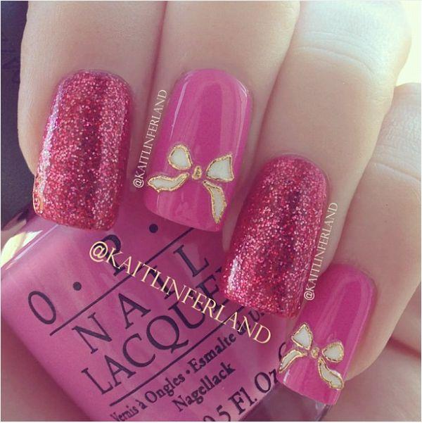 Glitter pink bow nail design