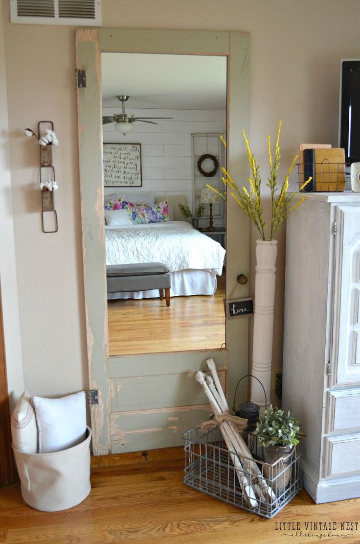 old door turned into full length wall mirror