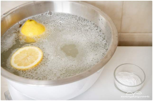 Bubbly baking soda and citrus foot soak to soften and refresh tired feet.