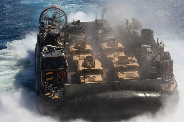A landing craft air cushion assigned to Assault Craft Unit 5 returns to the amphibious assault ship USS Makin Island. by Official U.S. Navy Imagery