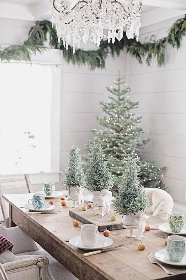 Love this shabby farmhouse style dining room with the gorgeous blue frosted spruce Christmas tree - Perfect tablescape and Christmas decorations.