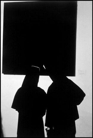 NEW YORK CITY—Two nuns viewing an Ad Reinhardt painting at a Museum of Modern Art opening, 1964. © Burt Glinn / Magnum Photos