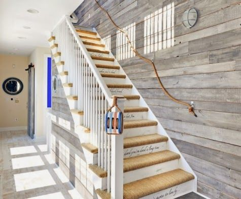 Nautical inspired stairway with rope: http://www.completely-coastal.com/2014/01/beach-house-turquoise-coral.html