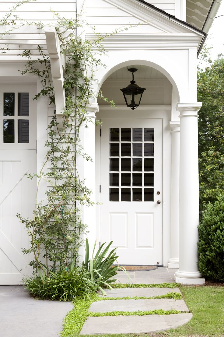 Carriage house entry porch • Trellis over garage doors