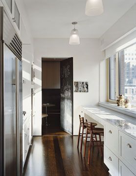 Galley kitchen with extended counter bar in NYC Residence by Fox-Nahem Associates interior design.
