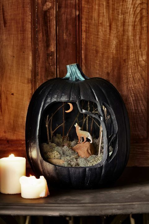Use black paint, moss, and other dramatic elements to give your pumpkin diorama a supernatural look. It's the perfect way for families to get crafty together!