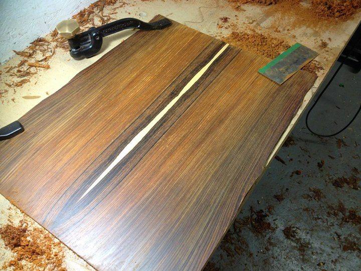 Bringing a cocobolo guitar back to final thickness with a hand scraper.  Custom order by master luthier Florian Vorreiter.  www.vorreiterguitars.com