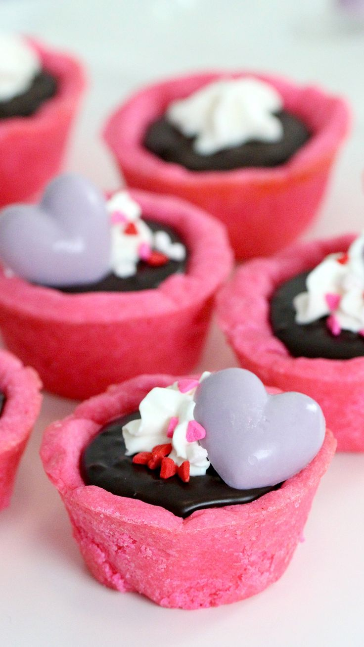 Pink sugar cookie tart shells filled with strawberry dark chocolate ganache. Perfect for a special someone or a Galentine's Day party!