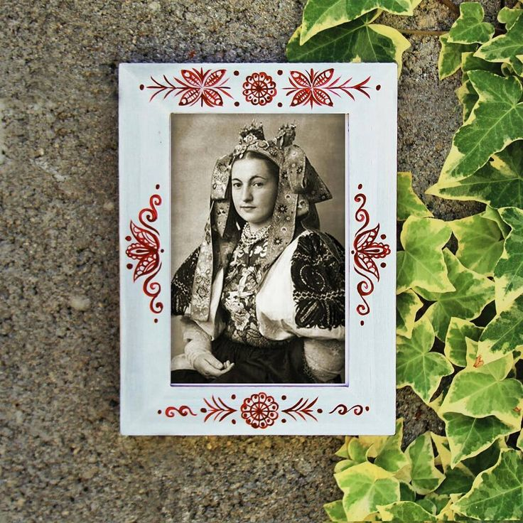 """Hand painted wooden photo frame. Made by Studio """"TalkFolk""""  *** the photo of the woman in the wedding costume belongs to #karolplicka and was made in 1953, genious photografer...  #talkfolk #folkpainting #paintingonwood #folklore #homedecoration #photoframe #ikeahack #modernyfolklor #slovenskyfolklor #milujemfolklor #slovakiahandmade #slovakia"""