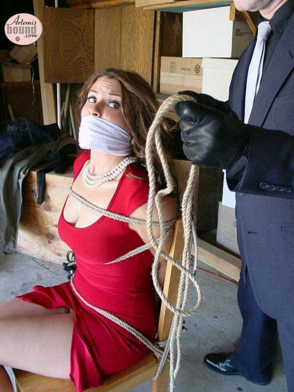 Beautiful woman has tied up boy toy 9