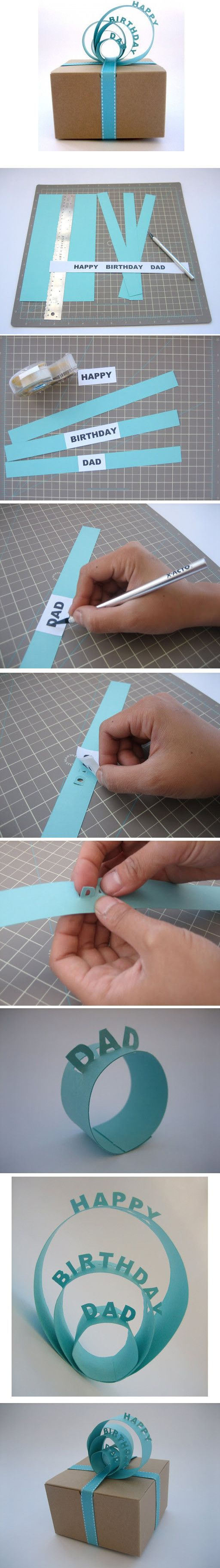 Create a pop-up message ribbon made of strips of paper. Check out below for instructions.
