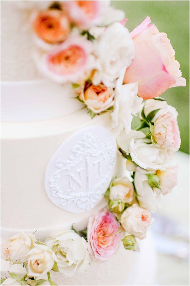 Elegant rose, blush and green flowers by Sidra Forman Flowers on multi tiered cake by Susan Gage Catering | Clear white tent by Sugar Plum Tents | Elegant and luxury design by DB3 Design | Ana Isabel Martinez Chamorro associate photographer for Mike Buscher Photography