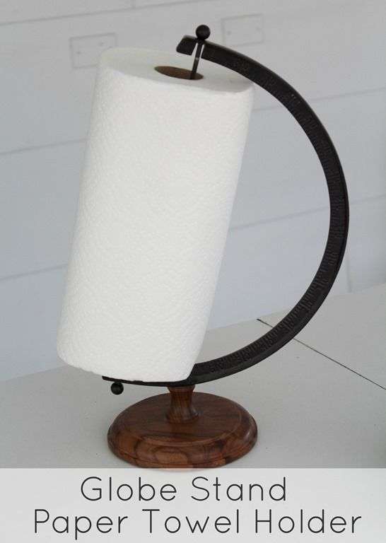 Unique paper towel holder made from an old globe stand - so simple and perfect for a farmhouse, cottage, or industrial style kitchen.