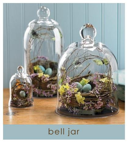 bell jars in all different sizes with spring decor underneath