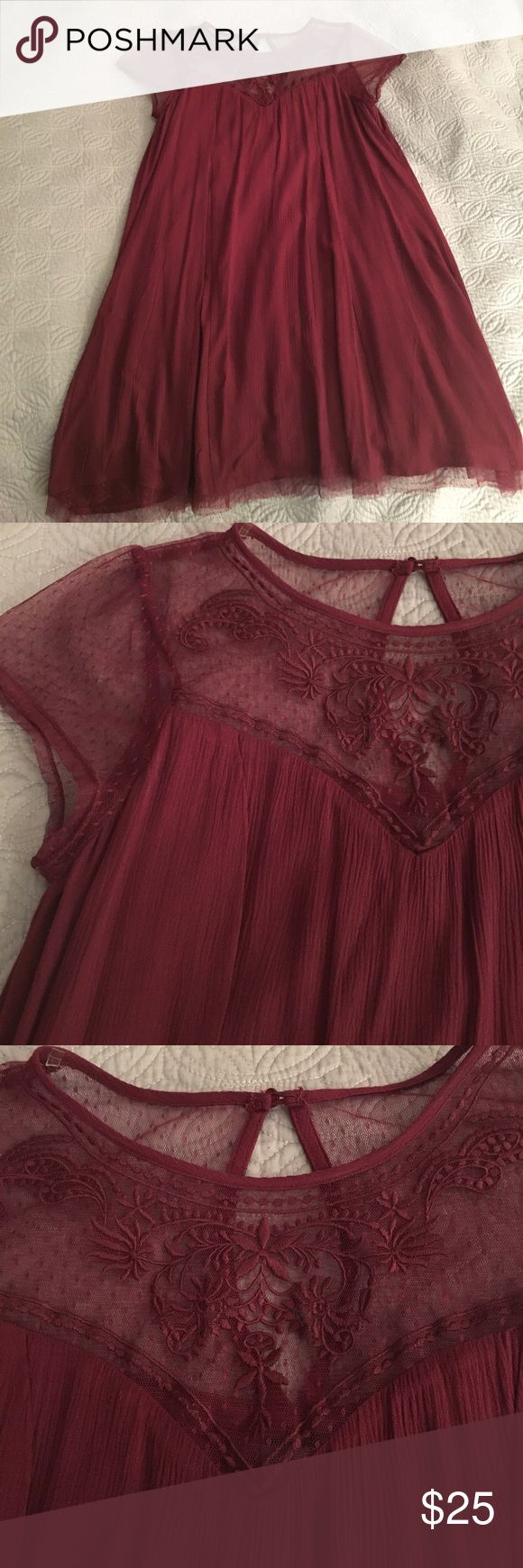 Lace Yoke Trapeze Swing Dress in Deep Burgundy Red Deep burgundy Dress with flattering swing princess seems and lace yoke. Keyhole back in pullover style (no sip). Bottom is strummed with the same adorable Swiss dot lace. Purchased to wear to a wedding, and work exactly once. It's super cute. Trixxi Dresses