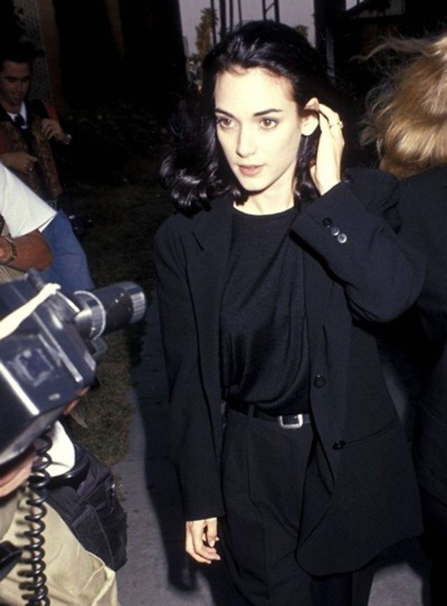 Winona Ryder: Black blazer, Black T, Black High Wasted Trouser & Baroque Shoe/Chelsea Boot/Ankle Converse Shoe
