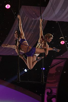 Janet Evans and Christine Van Loo in Celebrity Circus -- duo trapeze www.ChristineVanLoo.com www.AirBorneArts.com