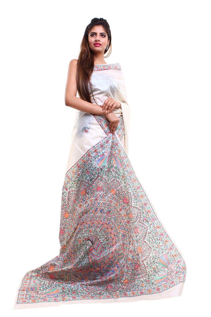 This is white coloured tassar silk saree featuring hand painted Madhubani art.