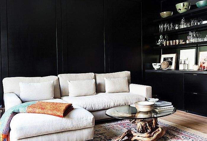 Why, oh why are we so head-over-heels for black? Let us count the ways: It's glamorous, striking, and just different enough. Its rock 'n' roll edginess is the perfect backdrop to a mind-blowing mix of materials from plush velvet to sleek glass, rustic wood to chic metal. And though it's considered a cool (as opposed to warm) shade, it gives spaces a jewel-box level of intimacy and coziness. Photo by Nicole LaMotte