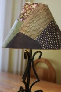 Repair a ripped lamp-shade with ModPodge and a scrapbook paper 'quilt'.