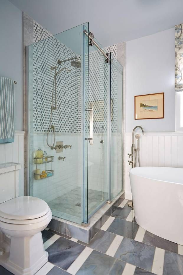 Instead of the usual custom shower enclosure, I installed a ready to go glass shower enclosure set that features a sliding door, so clearance into the room isn't an issue. The uber-stylish hardware that operates the slide mechanism made the leap from custom enclosure to prefab kit an easy and high-impact design choice. (Stacey Brandford)