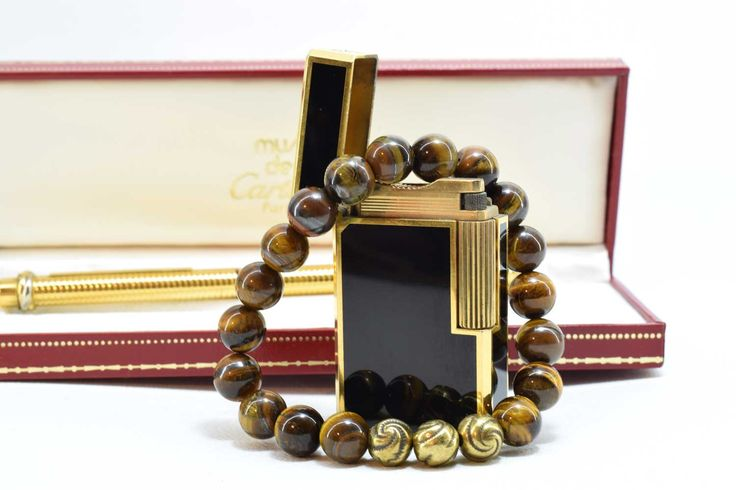Mens Bracelet, made with Tiger Eye Gemstone and Bronze metal beads. https://www.etsy.com/listing/520039841/tiger-eye-bracelet-mens-bracelet?ref=shop_home_active_4 #mensbracelet #menstyle #mensgift #bracelet