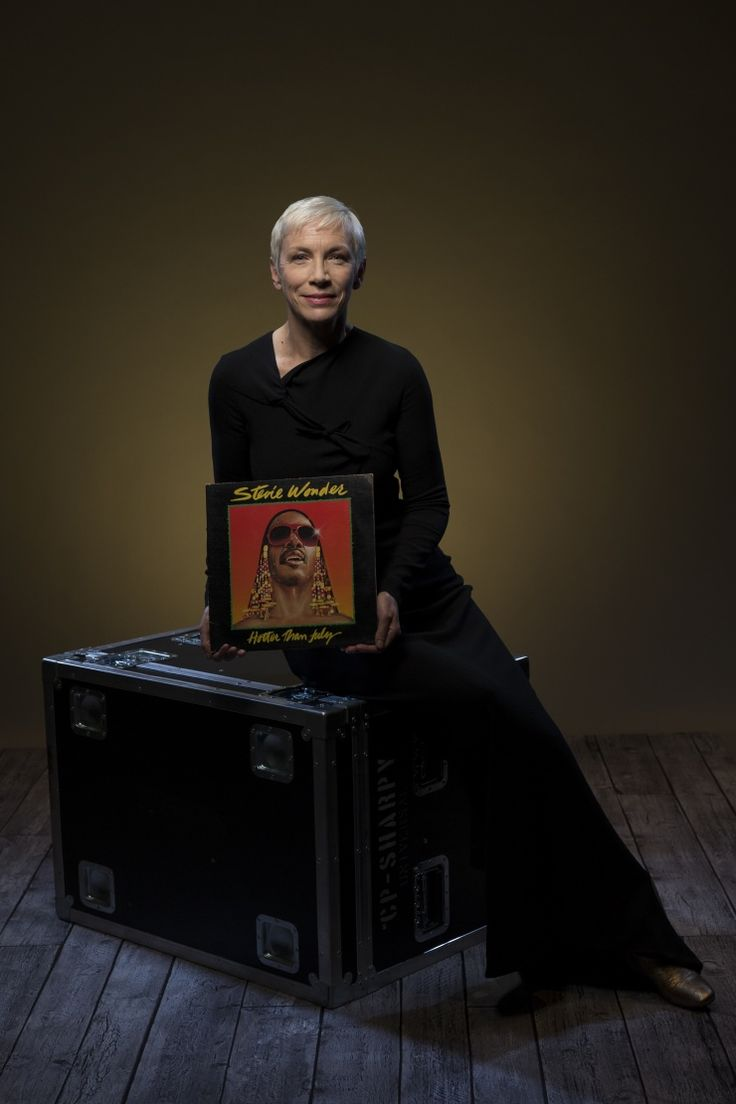 "Annie Lennox is photographed with a vinyl copy of Stevie Wonder's Hotter Than July backstage at the taping for ""Stevie Wonder: Songs In The Key Of Life — An All-Star GRAMMY Salute"" on Feb. 10 in Los Angeles"