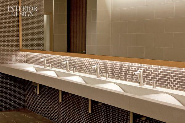 A Porcelain Tiled Backsplash And A Cast Stone Sink Trough In A Restroom Bathroom Public