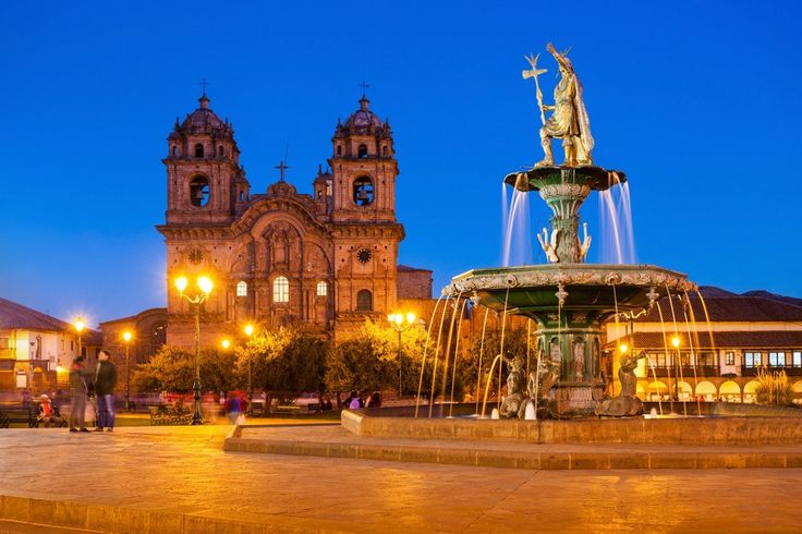Fountain at Plaza de Armas in Cusco at sunset