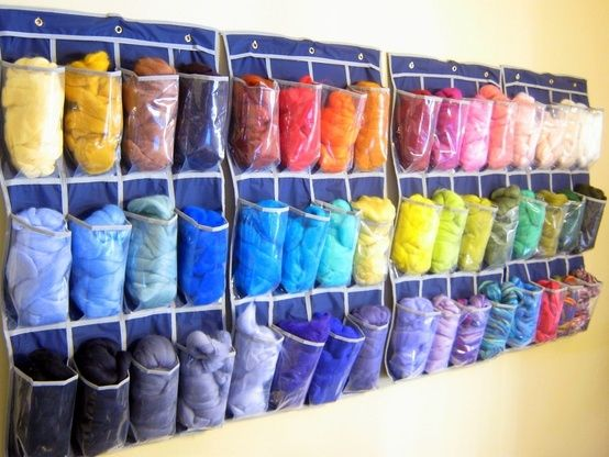 Use clear plastic shoe holders from the Dollar Tree to store yarn.