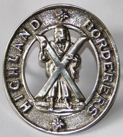 """HIGHLAND BORDERERS SILVER CAP BADGE. Extremely rare cast silver cap badge. St. Andrew to centre with """"HIGHLAND BORDERERS"""" to outside circle. Long lugs for feather bonnet so possibly pipe band. Nice condition. The Highland Borderers became the 3rd Battalion A & S.H. in 1881"""
