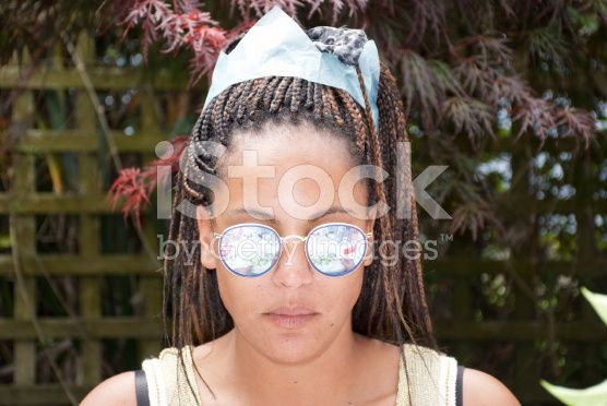 Female wearing a Hat from a Christmas Cracker, Summer Christmas royalty-free stock photo